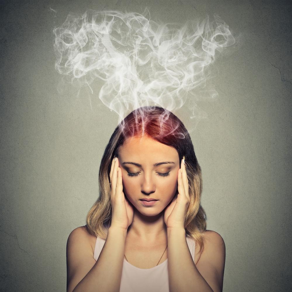 Gesunde Organisation Psychische Störungen Frau mit rauchendem Kopf.jpeg